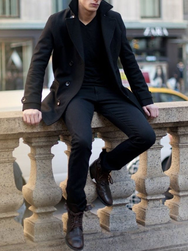 Men's outfit idea for 2021 with black single-breasted overcoat, black v-neck t-shirt, black jeans, black casual belt, black chelsea boots. Suitable for spring, fall and winter.