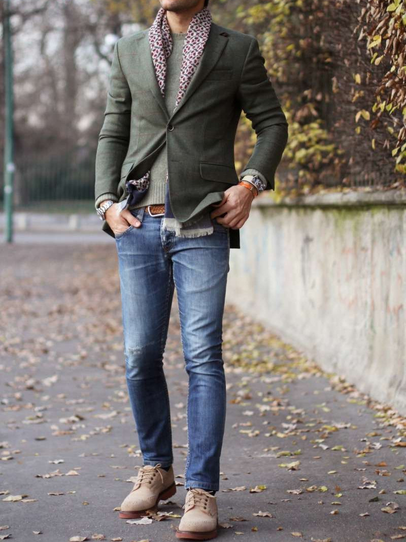 Men's outfit idea for 2021 with plaid blazer, green plain crew neck knitted sweater, mid blue jeans, suede shoes / desert shoes. Suitable for spring and fall.
