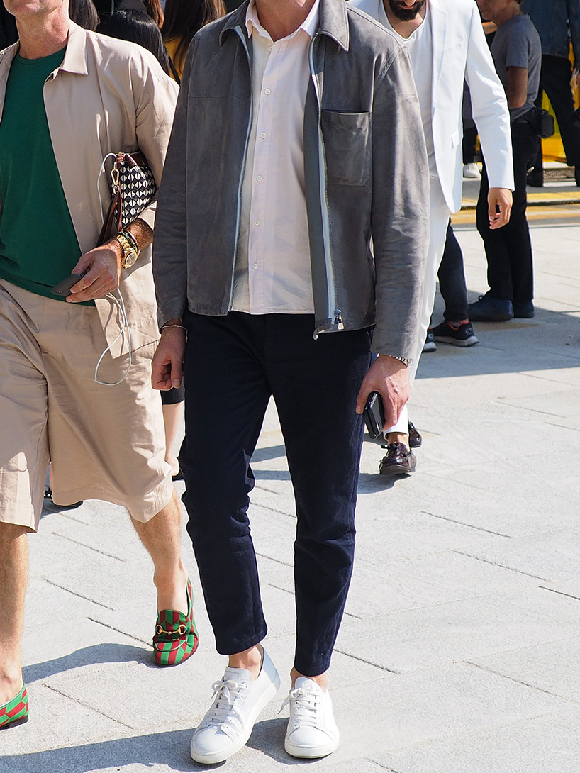 Men's outfit idea for 2021 with grey jacket, white casual shirt, navy chinos, white trainers. Suitable for spring, summer and autumn.