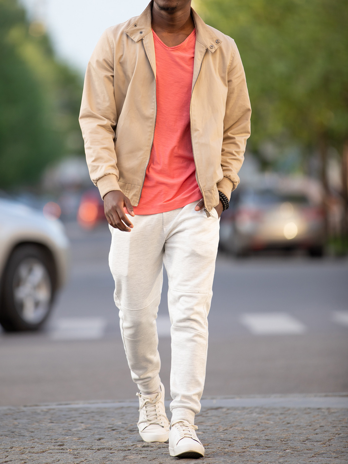 Men's outfit idea for 2021 with neutral harrington jacket, pink plain crew neck t-shirt, white sneakers. Suitable for spring, summer and fall.
