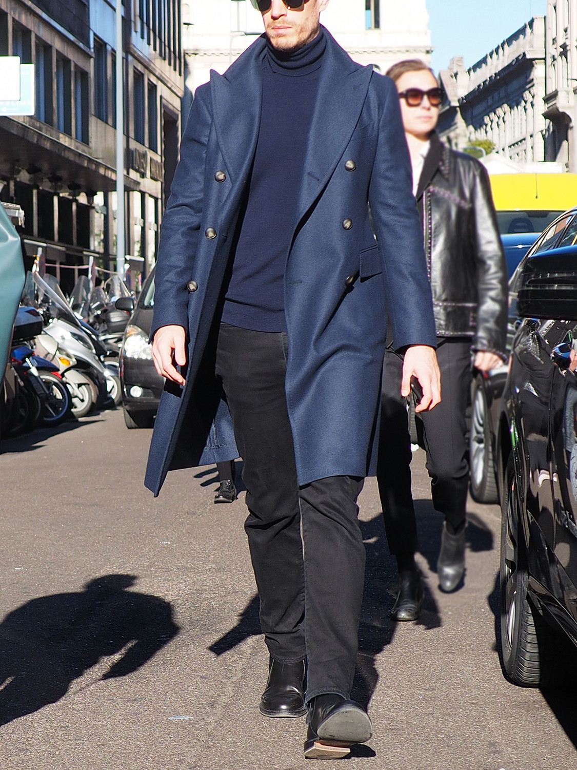 Men's outfit idea for 2021 with double-breasted overcoat, navy lightweight rollneck jumper, black jeans, black chelsea boots. Suitable for autumn and winter.