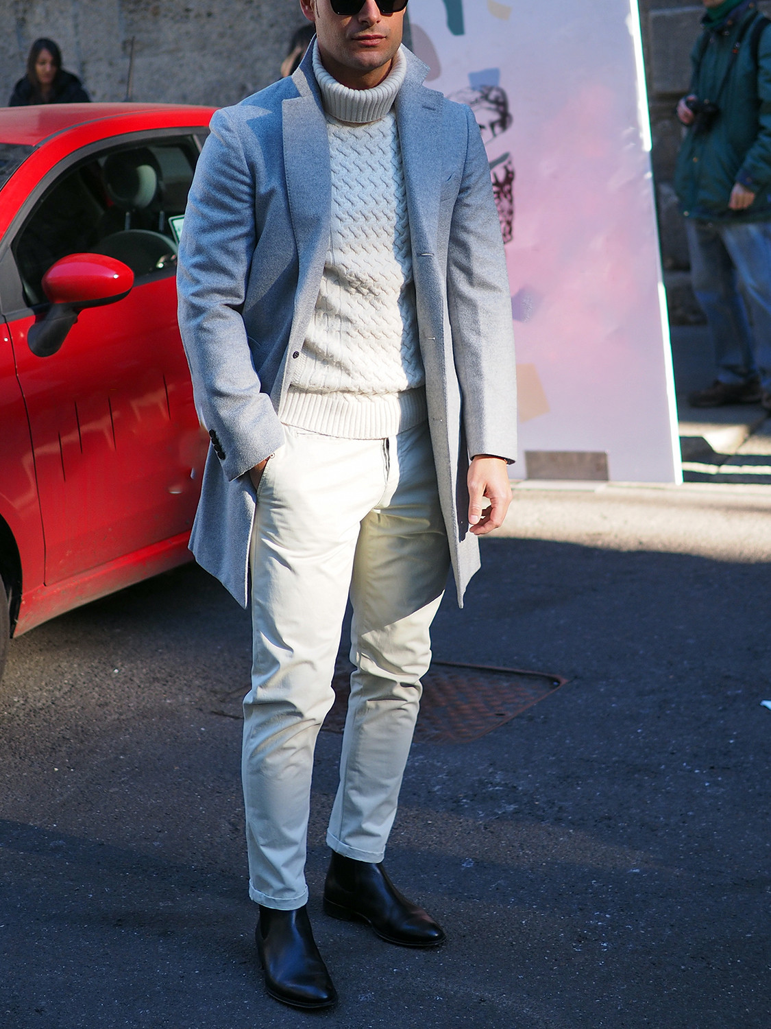 Men's outfit idea for 2021 with grey single-breasted overcoat, white chinos, black chelsea boots. Suitable for autumn and winter.