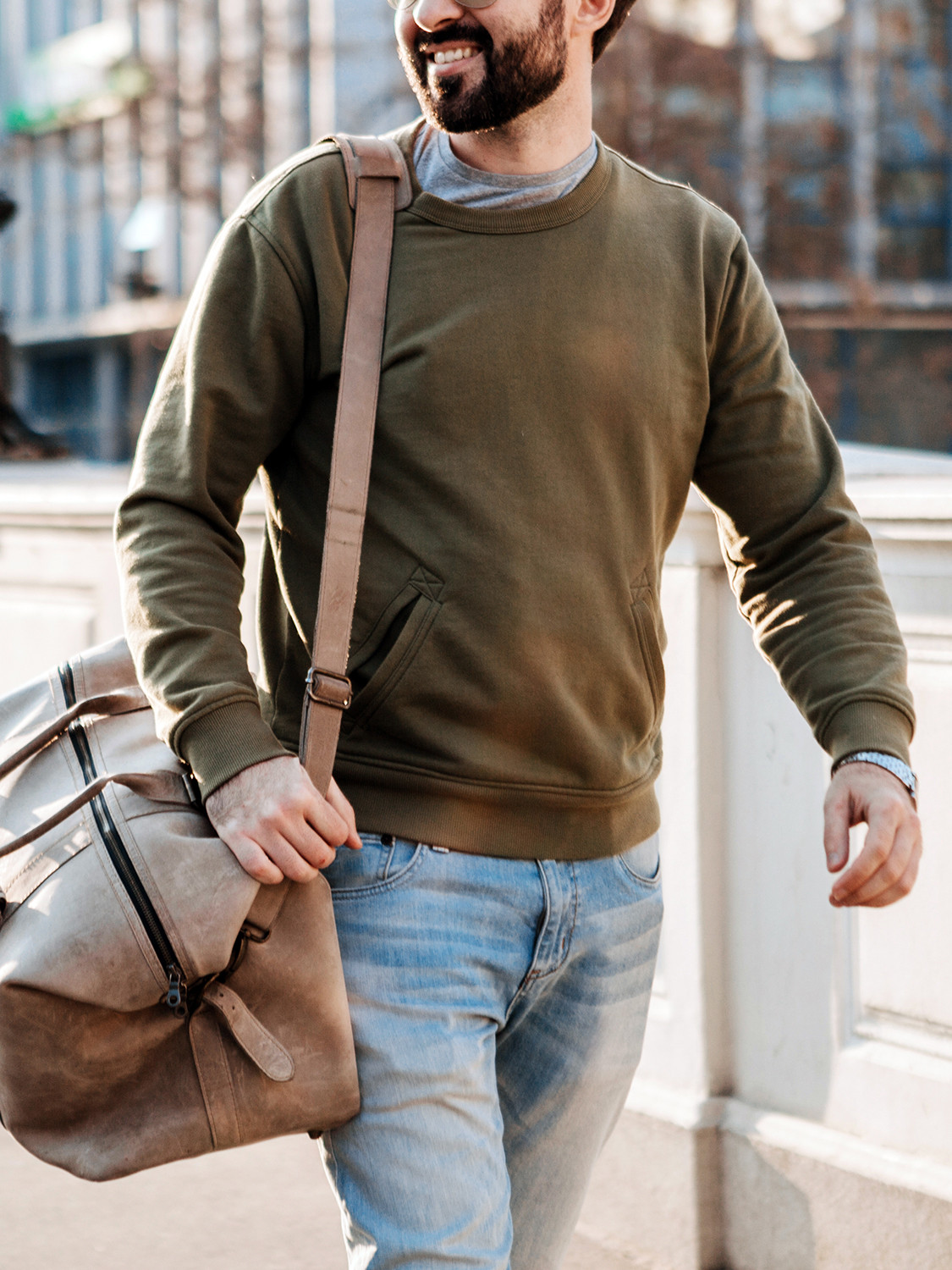 Men's outfit idea for 2021 with green plain sweatshirt, gray crew neck t-shirt, mid blue jeans. Suitable for spring and fall.