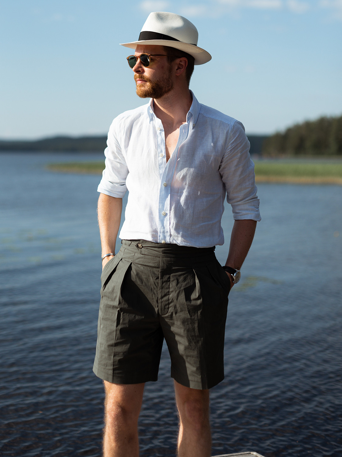 Men's outfit idea for 2021 with white linen shirt, green cotton shorts. Suitable for summer.