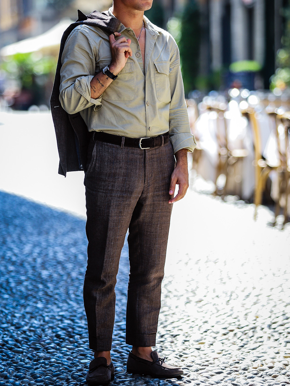Men's outfit idea for 2021 with textured blazer, pale coloured casual shirt, brown plain formal trousers, brown loafers. Suitable for spring, summer and autumn.