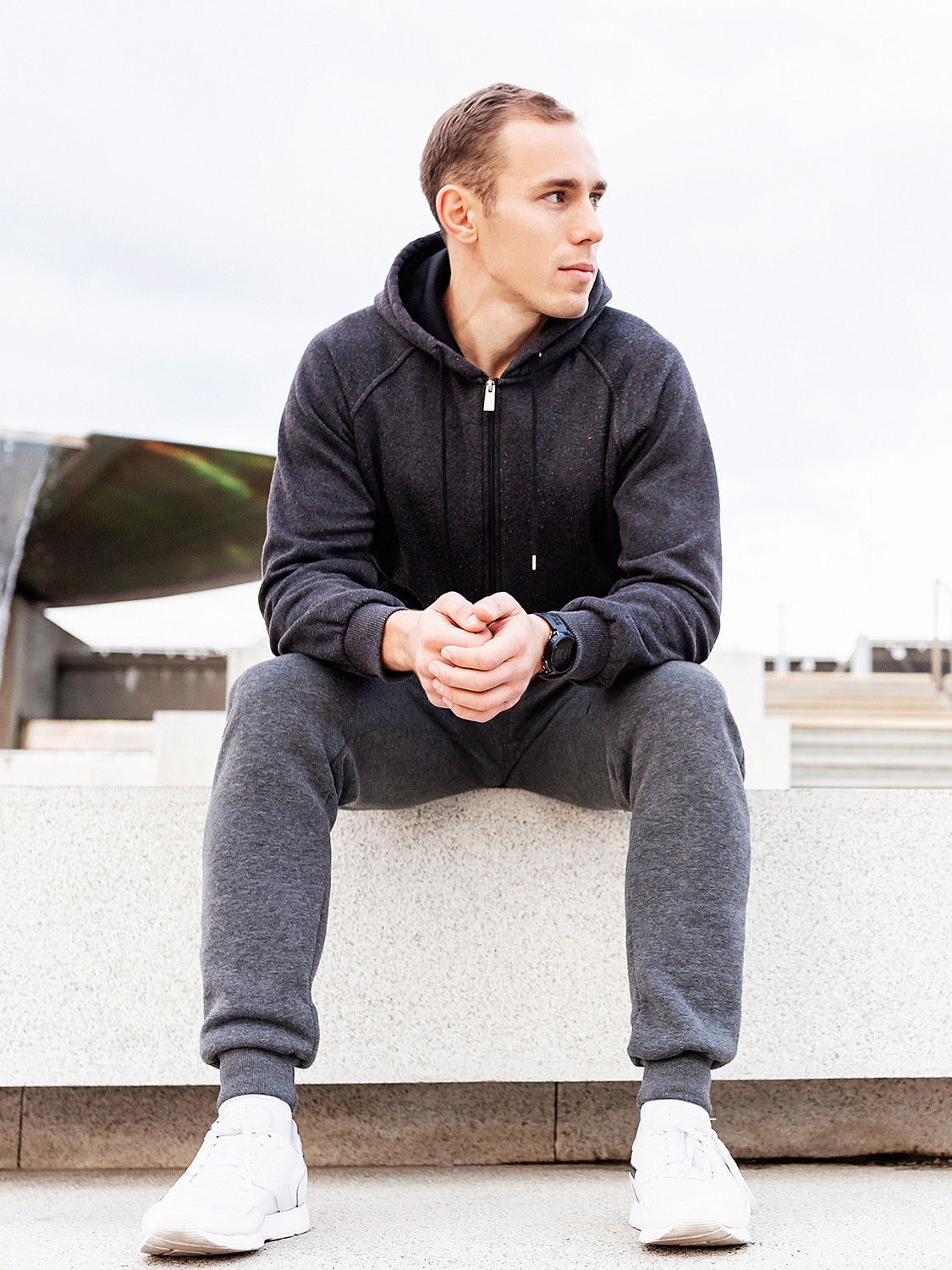 Men's outfit idea for 2021 with gray hoodie, white crew neck t-shirt, grey sweatpants, white sneakers. Suitable for spring, summer, fall and winter.