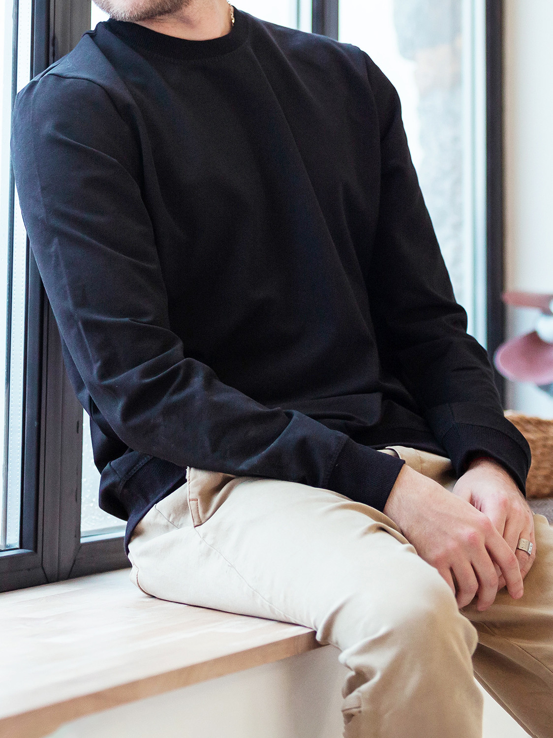 Men's outfit idea for 2021 with navy plain sweatshirt, grey plain crew neck t-shirt, neutral chinos, brown boat shoes. Suitable for spring and fall.
