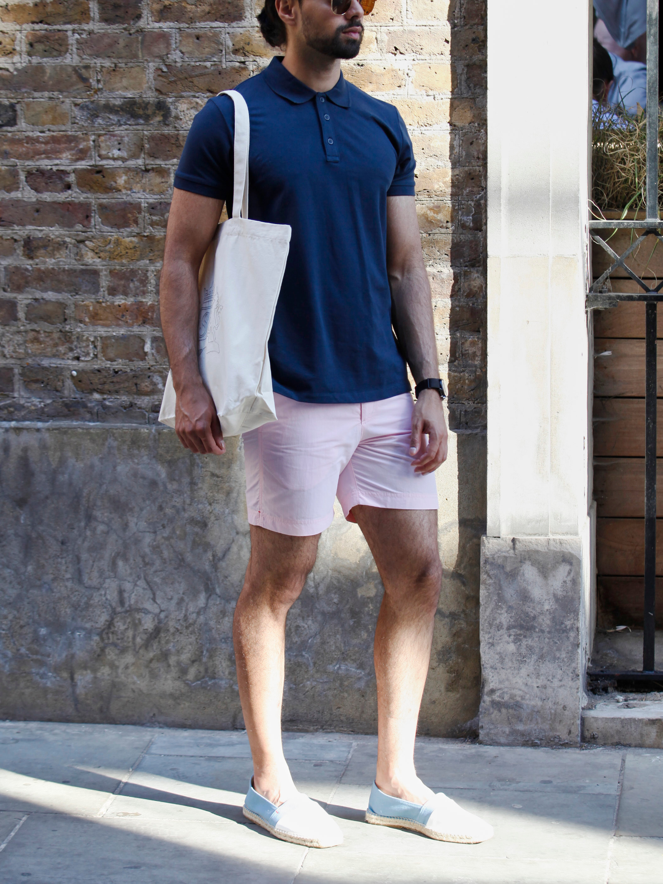Men's outfit idea for 2021 with navy polo, swimwear, leather strap watch, espadrilles. Suitable for summer.