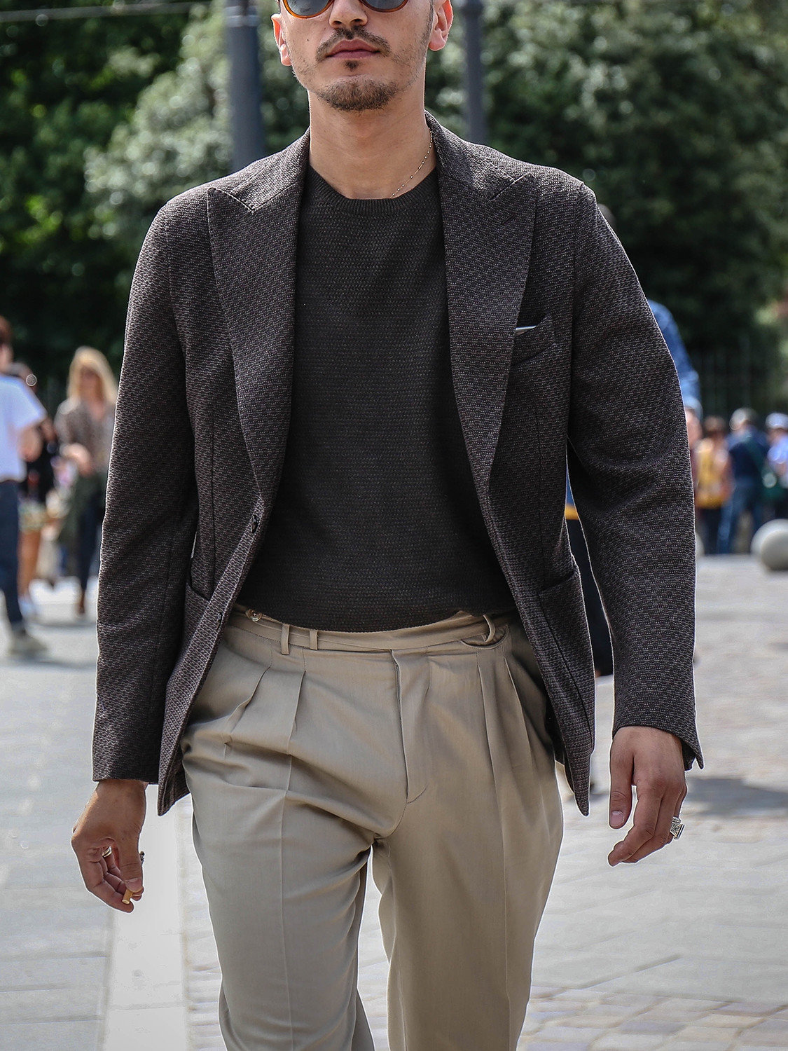 Men's outfit idea for 2021 with grey plain crew neck knitted jumper, stone chinos. Suitable for spring, summer and autumn.