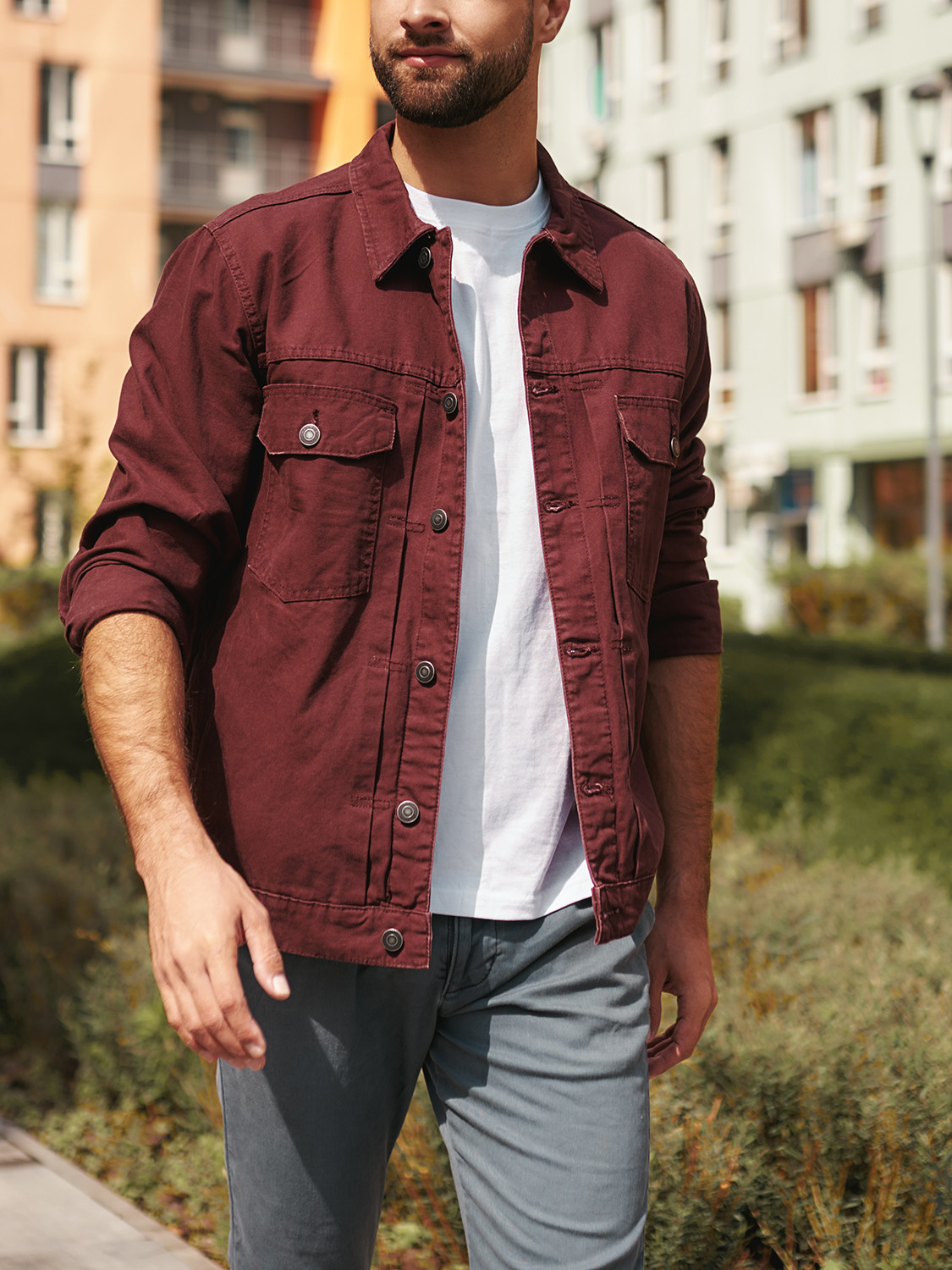 Men's outfit idea for 2021 with red overshirt, white crew neck t-shirt, grey chinos, white sneakers. Suitable for spring and fall.