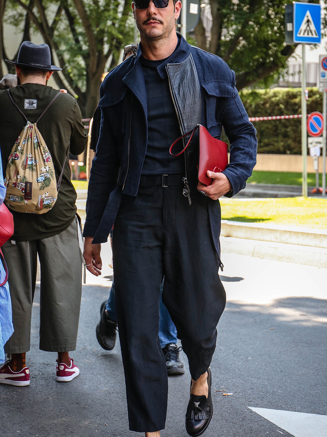 Men's outfit idea for 2021 with navy bomber jacket, navy plain long-sleeved t-shirt, navy linen trousers, black thick framed sunglasses, black loafers. Suitable for spring, summer and autumn.