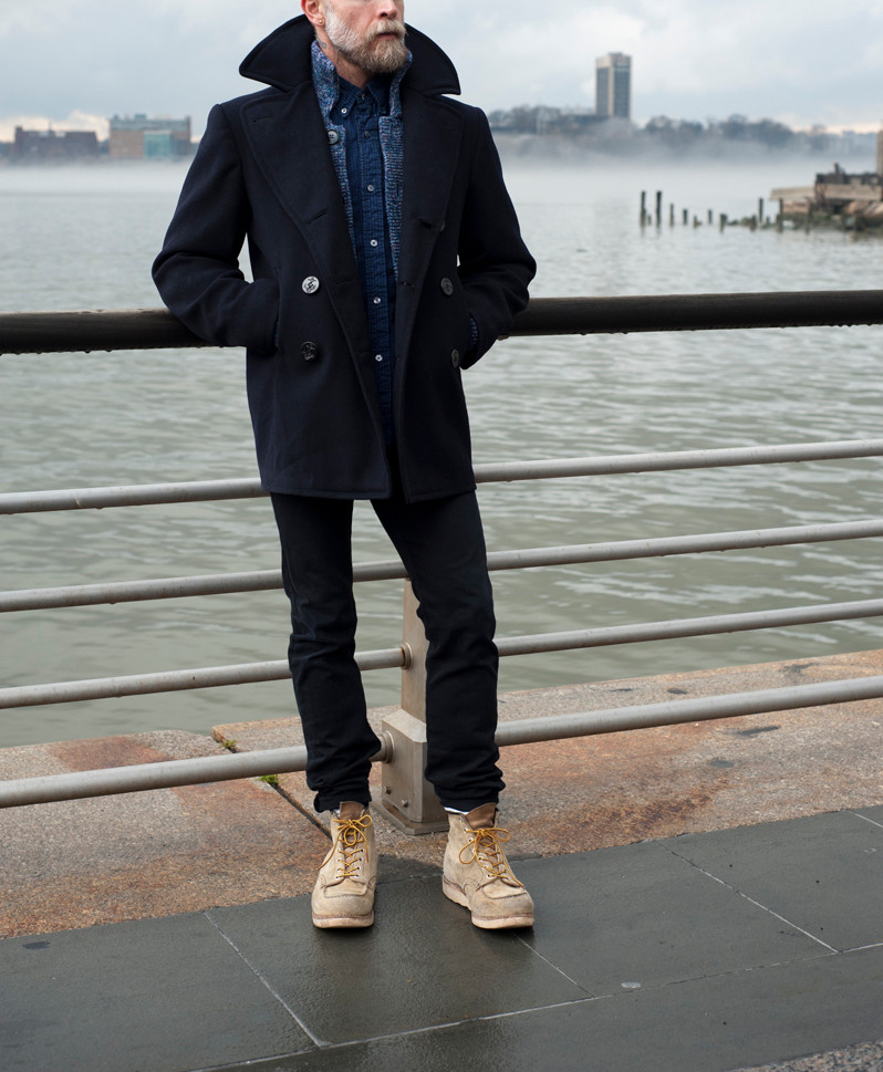 Men's outfit idea for 2021 with peacoat, shawl cardigan, navy casual shirt, black jeans, workboots. Suitable for fall and winter.