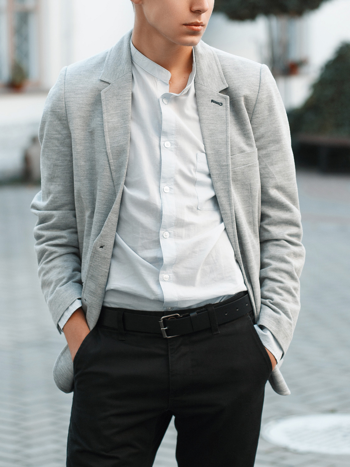 Men's outfit idea for 2021 with grey plain blazer, blue plain casual shirt, black chinos, black chelsea boots. Suitable for spring, summer and autumn.
