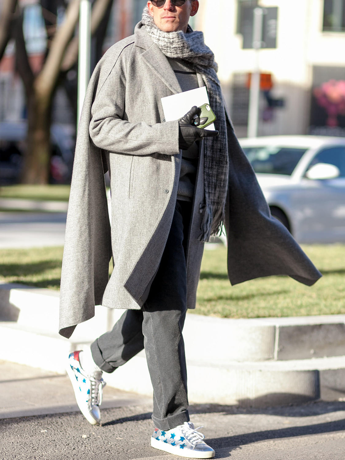 Men's outfit idea for 2021 with neutral double-breasted overcoat, gray sweatshirt, grey chinos, grey plain knitted scarf. Suitable for fall and winter.