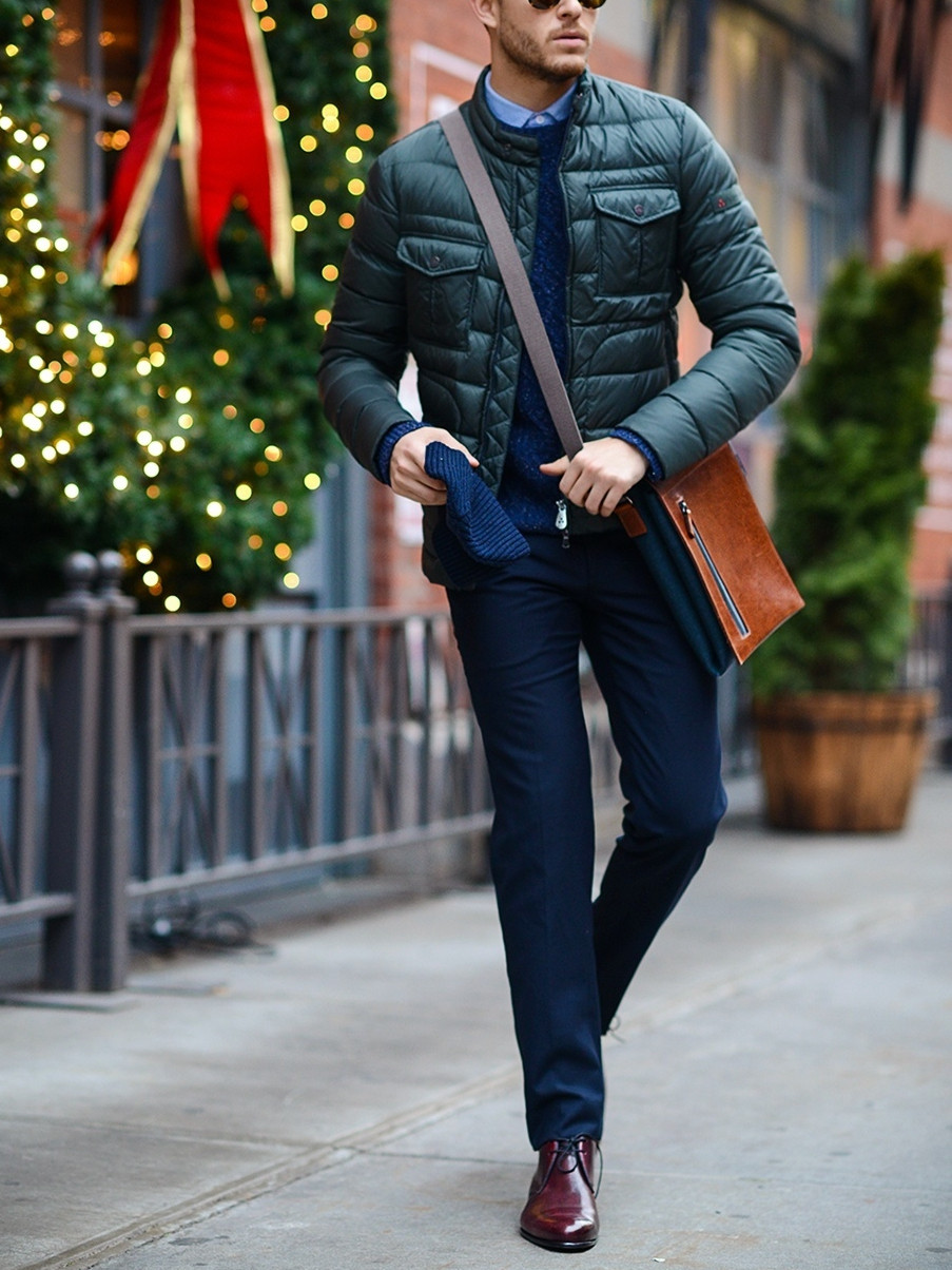 Men's outfit idea for 2021 with quilted jacket, cable-knit sweater, blue dress shirt, navy dress pants, brown oxford / derby shoes. Suitable for spring, fall and winter.