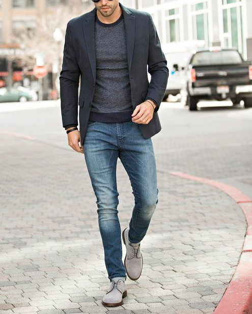 Men's outfit idea for 2021 with navy blazer, striped jumper, mid blue jeans, grey suede shoes / desert shoes. Suitable for spring, autumn and winter.