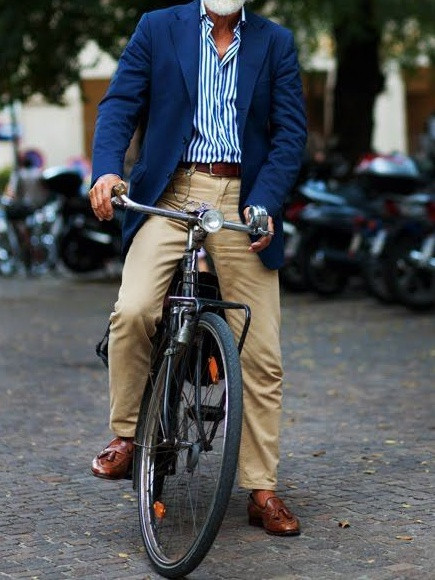Men's outfit idea for 2021 with navy blazer, striped casual shirt, stone chinos, brown casual belt, brown loafers. Suitable for spring, autumn and winter.
