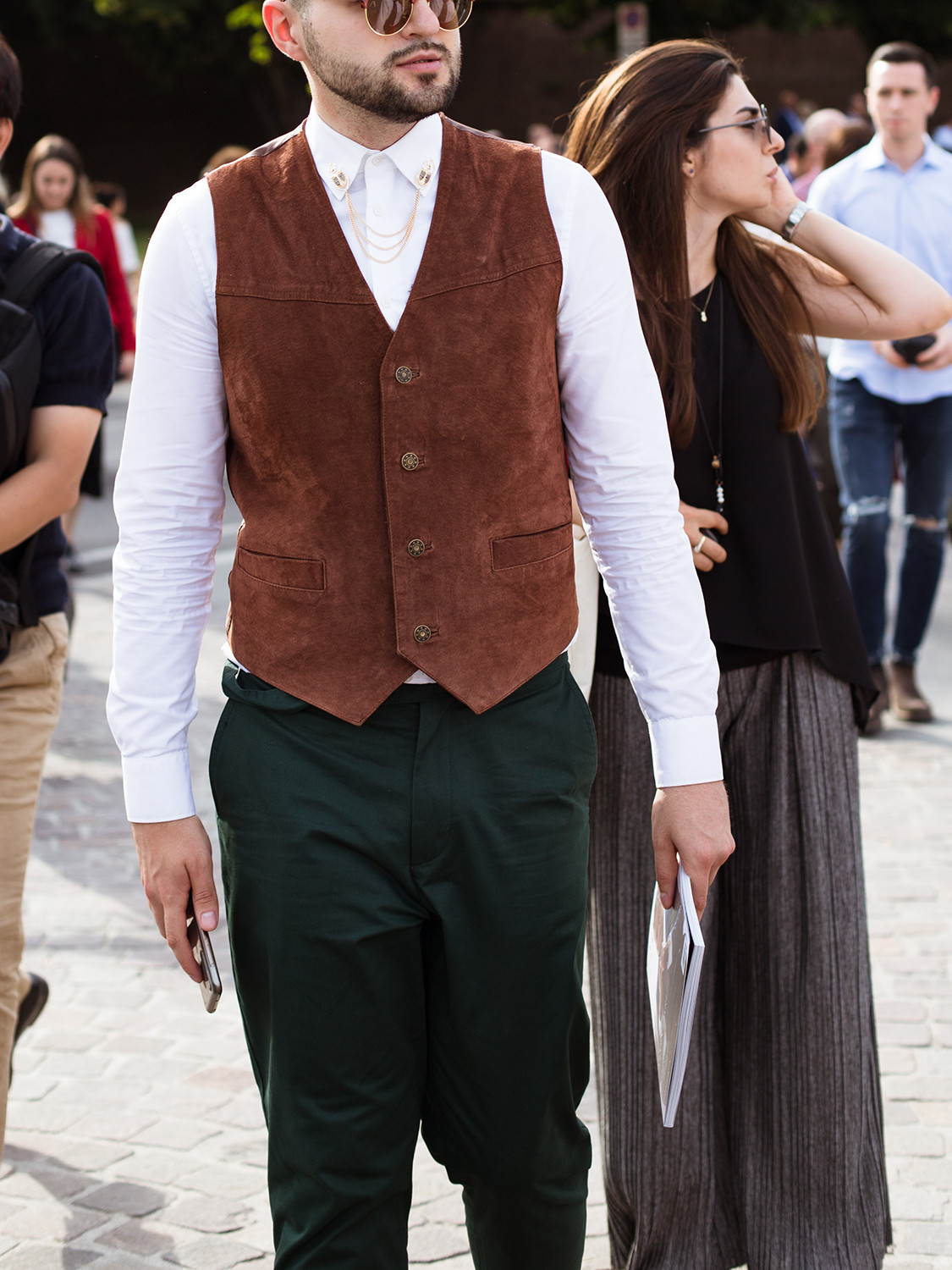 Men's outfit idea for 2021 with brown waistcoat, white casual shirt, black plain formal trousers, brown oxford / derby shoes. Suitable for spring, summer and autumn.