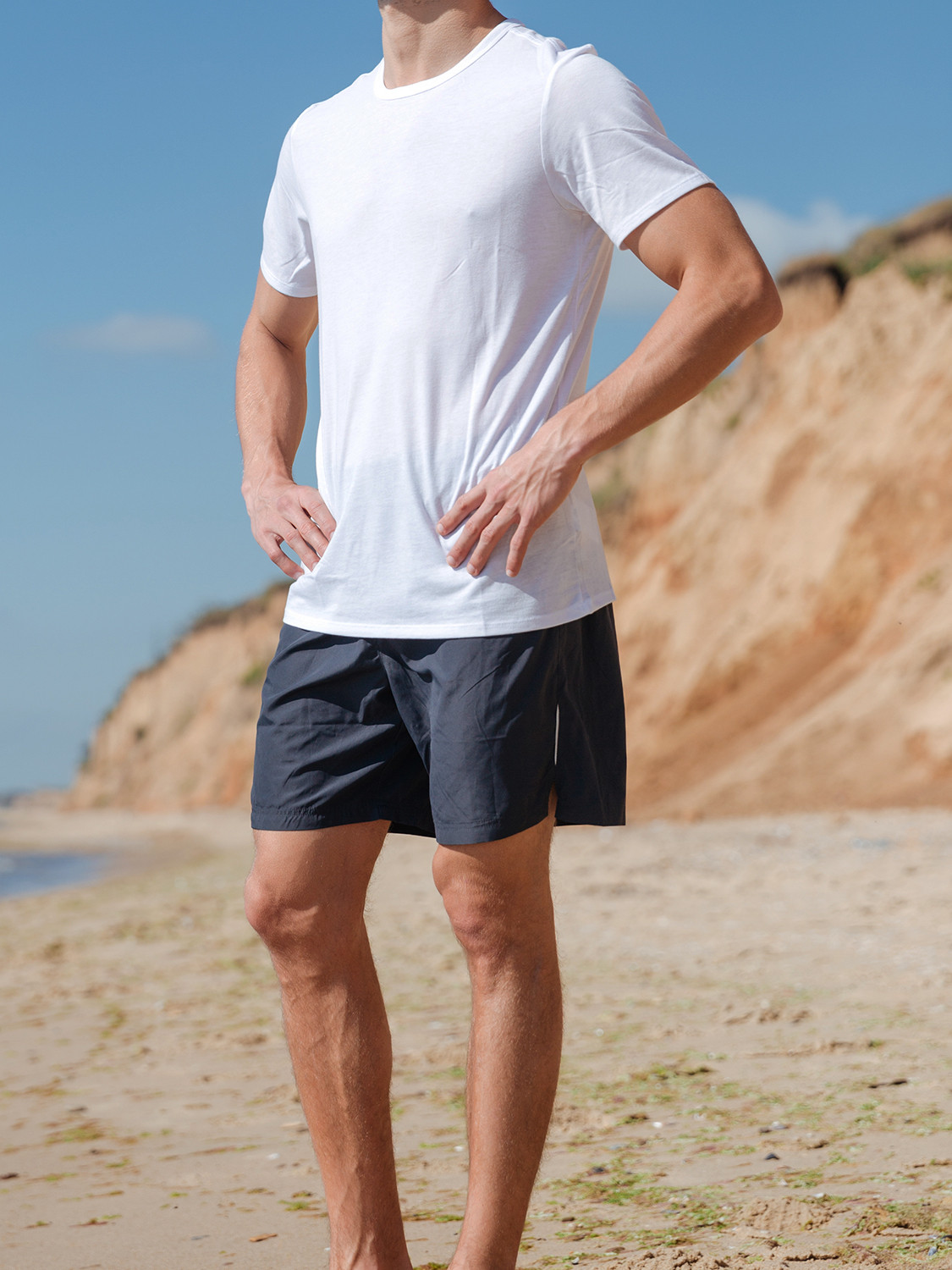 Men's outfit idea for 2021 with white crew neck t-shirt, navy swimming shorts. Suitable for summer.