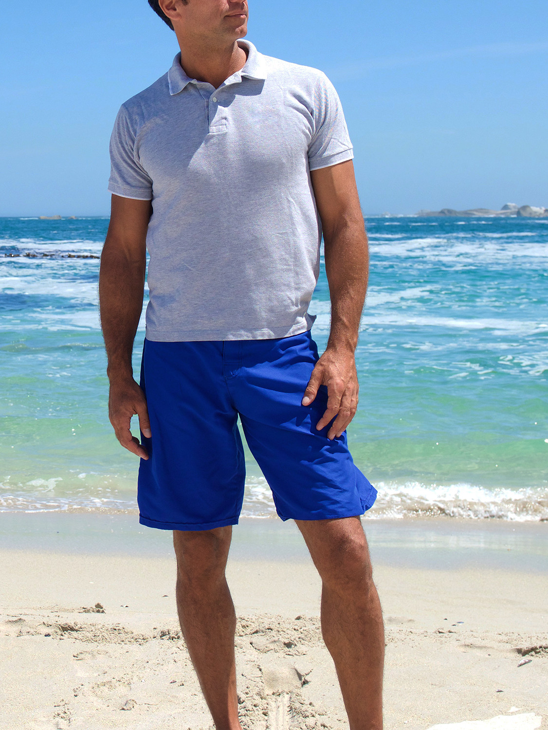 Men's outfit idea for 2021 with blue plain short-sleeved polo, blue swimwears. Suitable for summer.