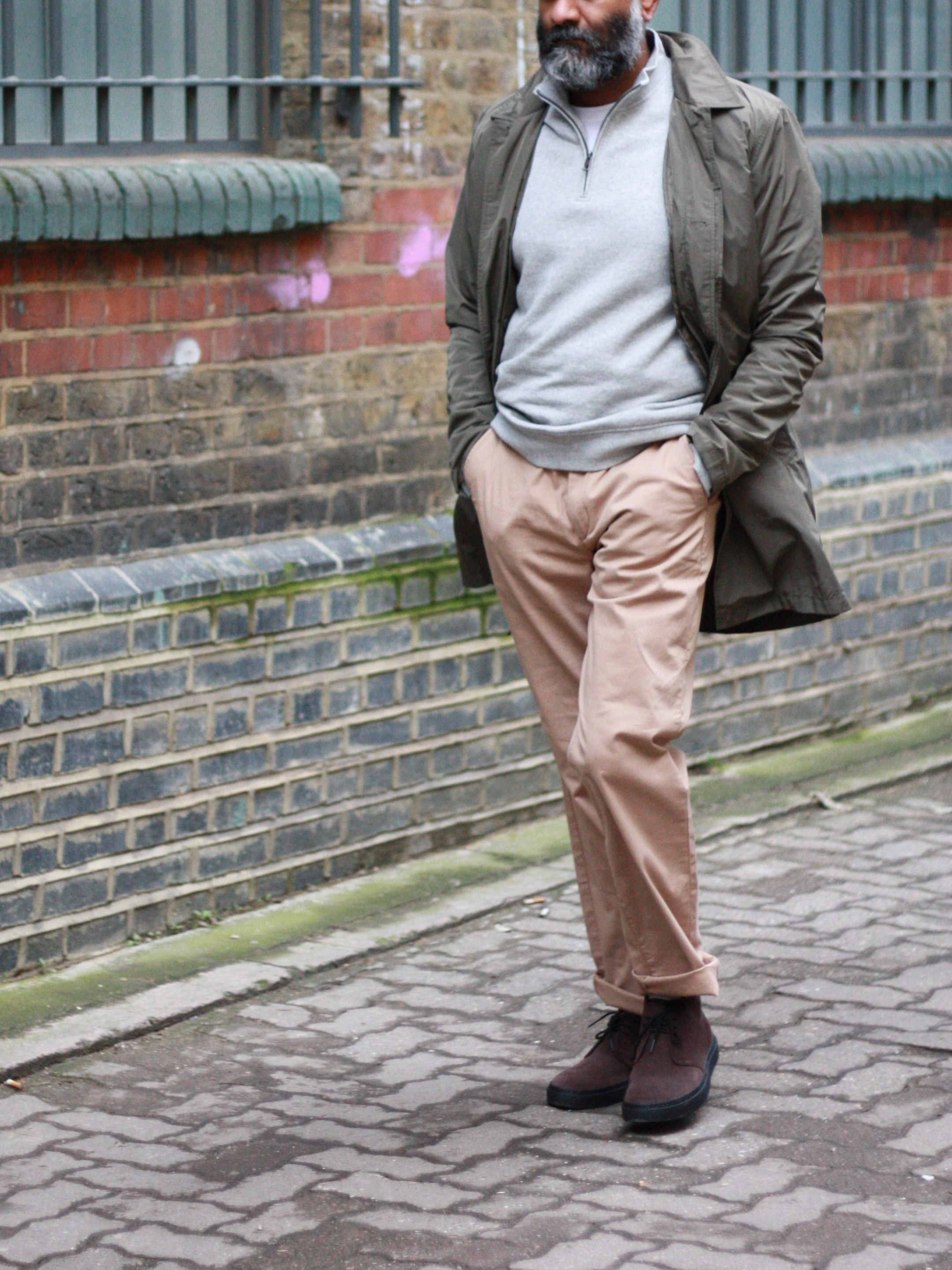 Men's outfit idea for 2021 with field jacket, half-zip / half-button jumper, stone chinos, chukka boots. Suitable for spring and autumn.