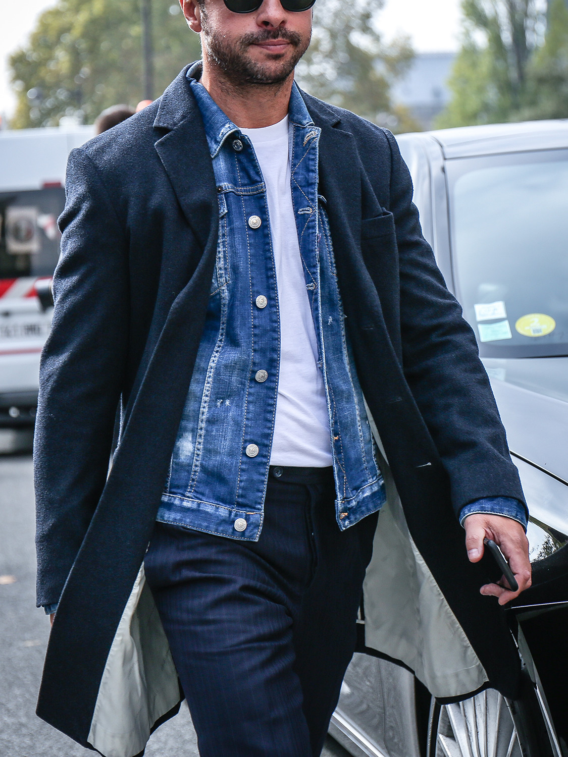 Men's outfit idea for 2021 with navy single-breasted overcoat, blue denim jacket, white crew neck t-shirt, navy formal trousers. Suitable for spring, autumn and winter.