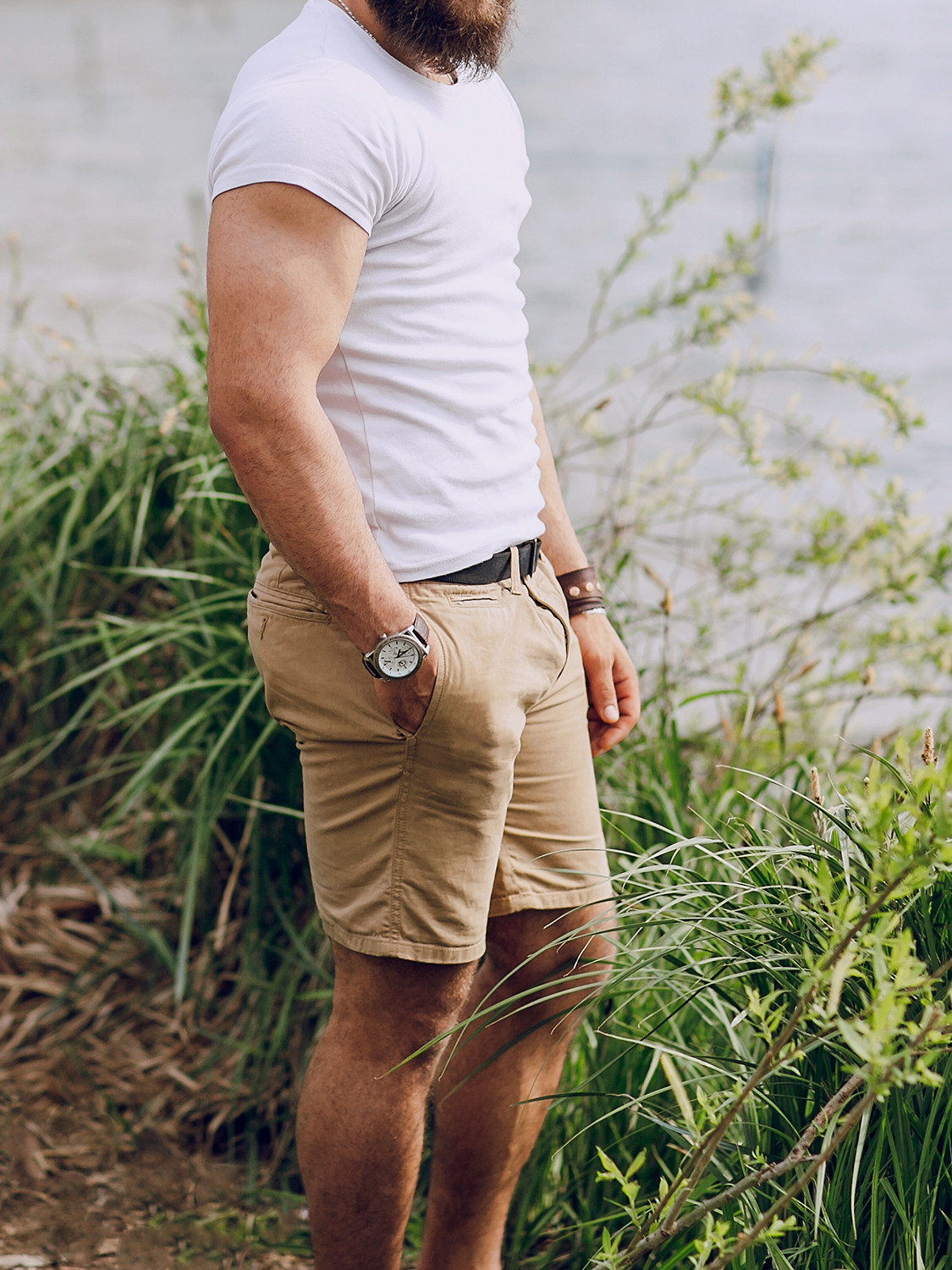 Men's outfit idea for 2021 with white crew neck t-shirt, neutral cotton shorts, grey espadrilles. Suitable for summer.