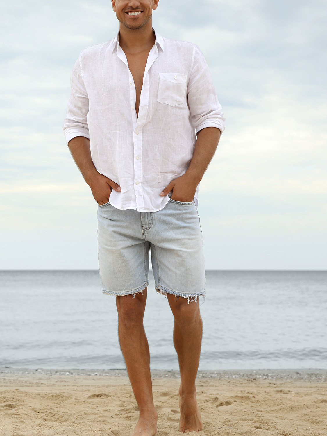 Men's outfit idea for 2021 with white linen shirt, blue denim shorts, neutral espadrilles. Suitable for spring and summer.