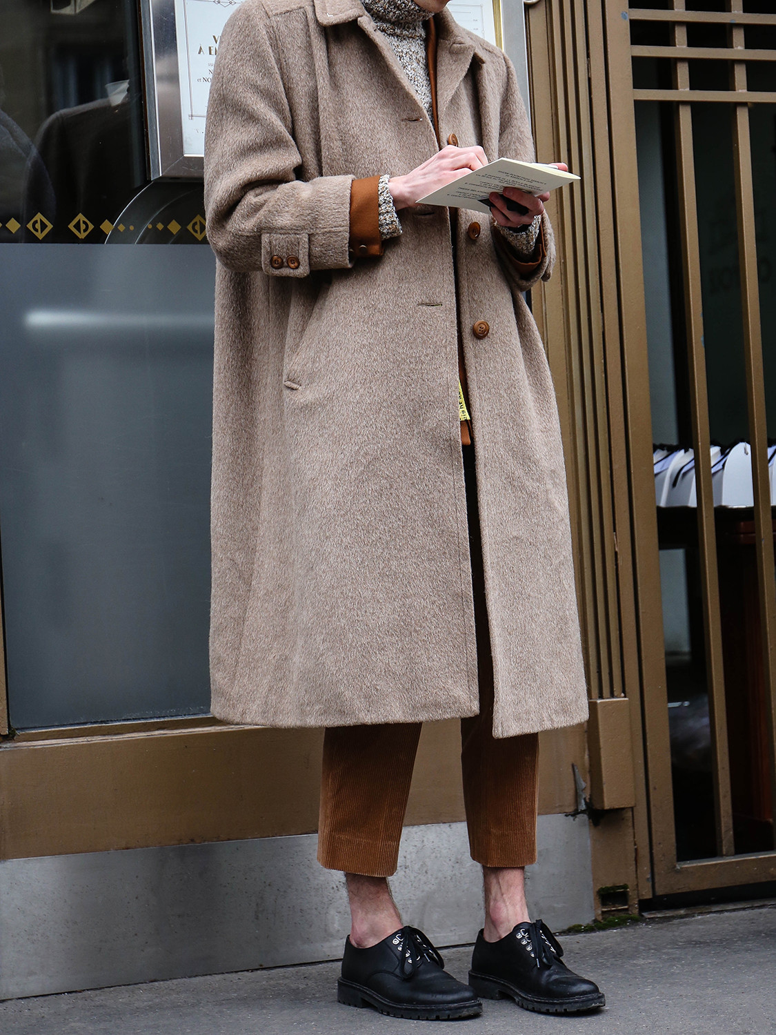 Men's outfit idea for 2021 with neutral camel coat, utility jacket, neutral lightweight rollneck sweater, black oxford / derby shoes. Suitable for winter.