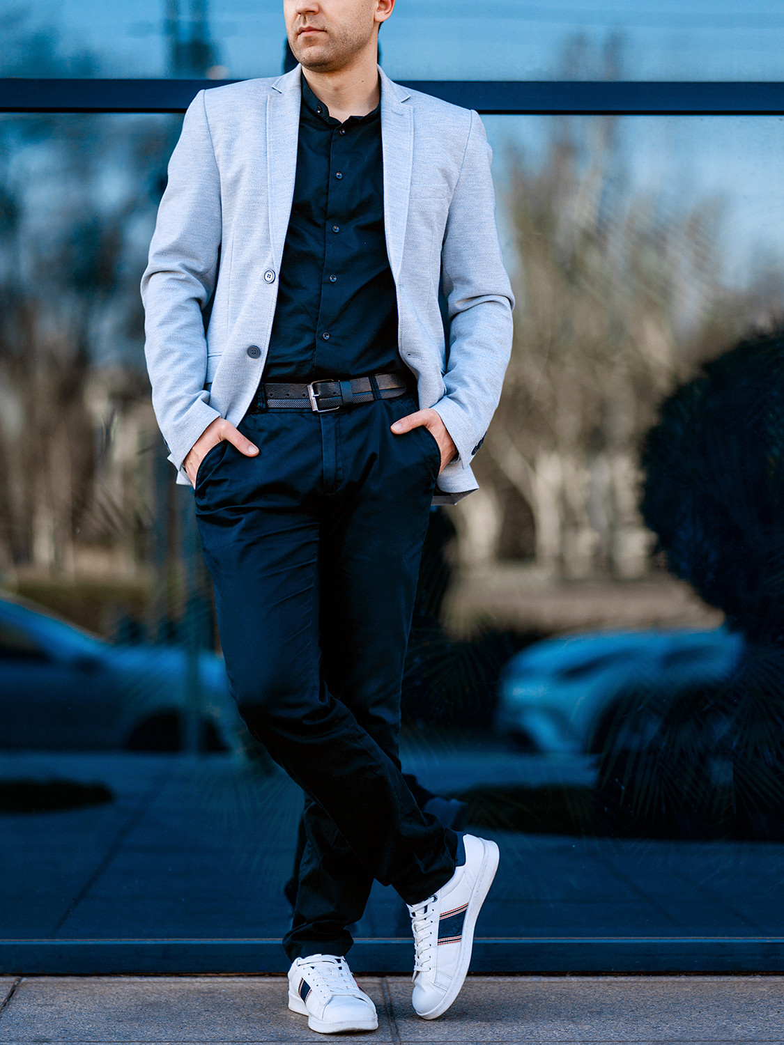 Men's outfit idea for 2021 with blue plain blazer, navy plain casual shirt, navy chinos, white trainers / sneakers. Suitable for spring and autumn.