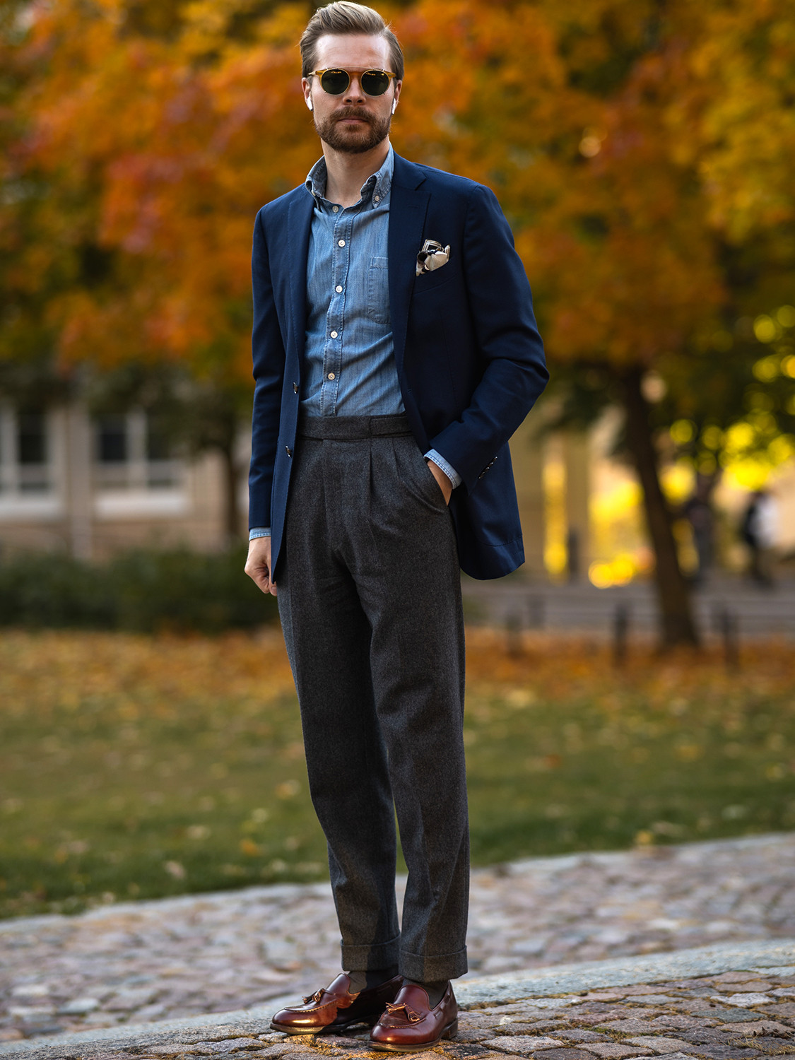 Men's outfit idea for 2021 with navy plain blazer, blue denim shirt, grey plain formal trousers, loafers. Suitable for spring and autumn.