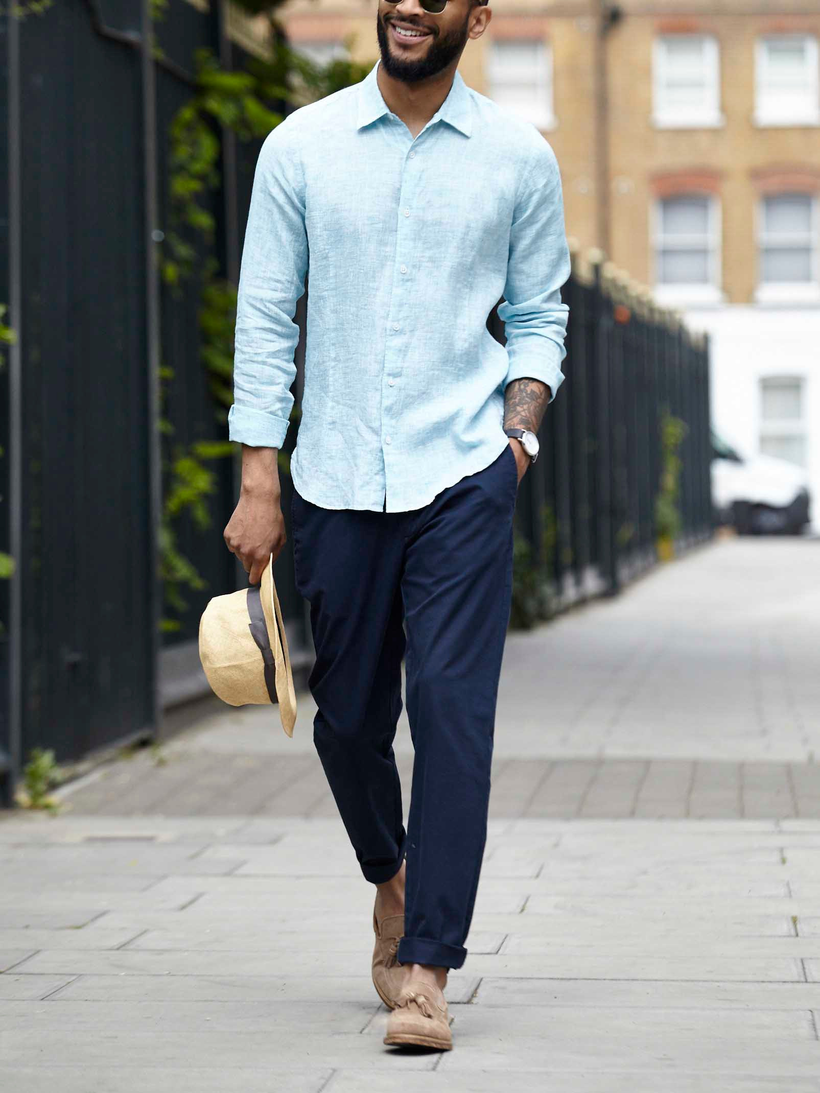 Men's outfit idea for 2021 with linen shirt, navy chinos, leather strap watch, loafers. Suitable for summer.