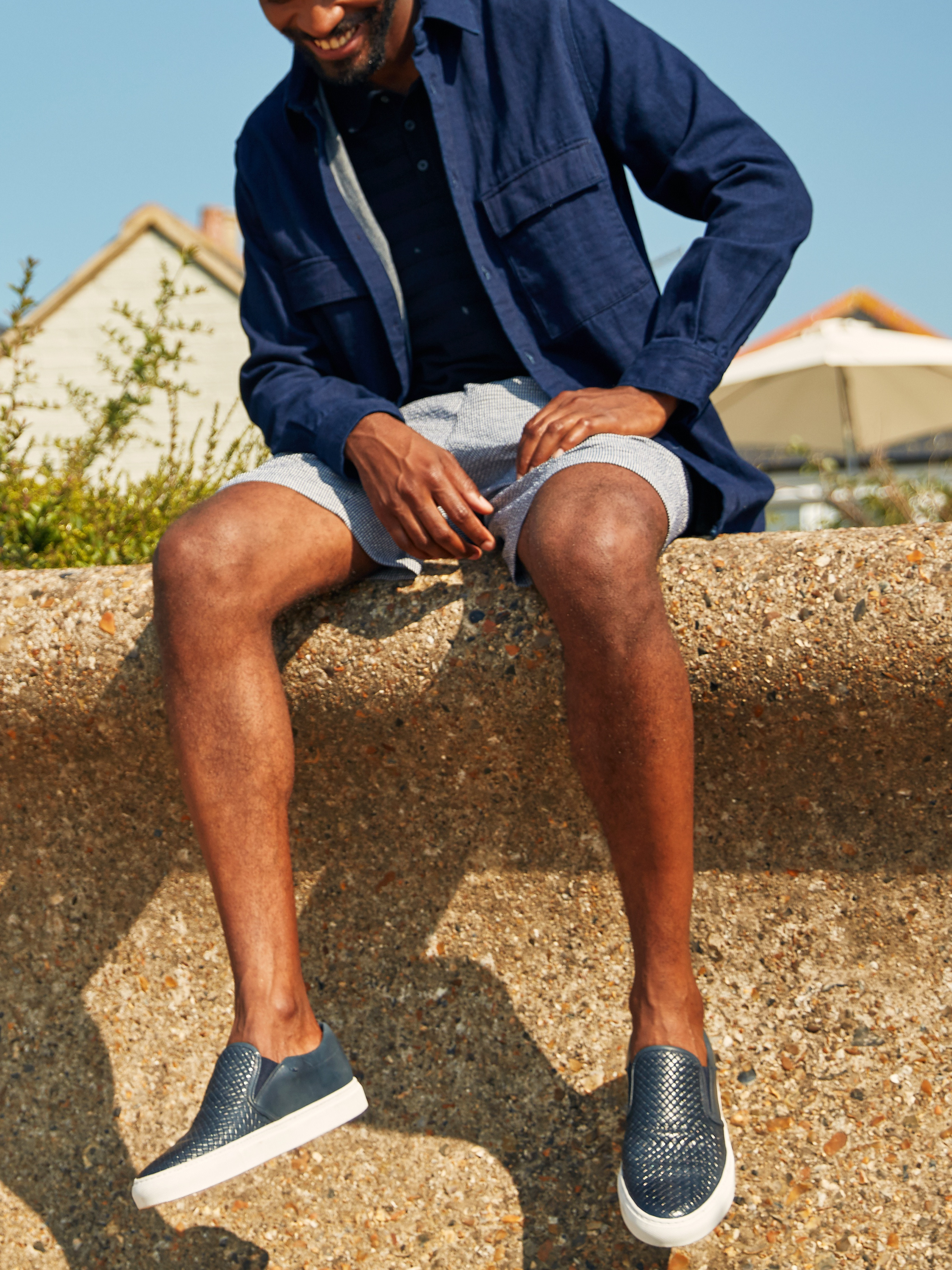 Men's outfit idea for 2021 with utility jacket, denim shirt, coloured / patterned shorts. Suitable for spring and summer.