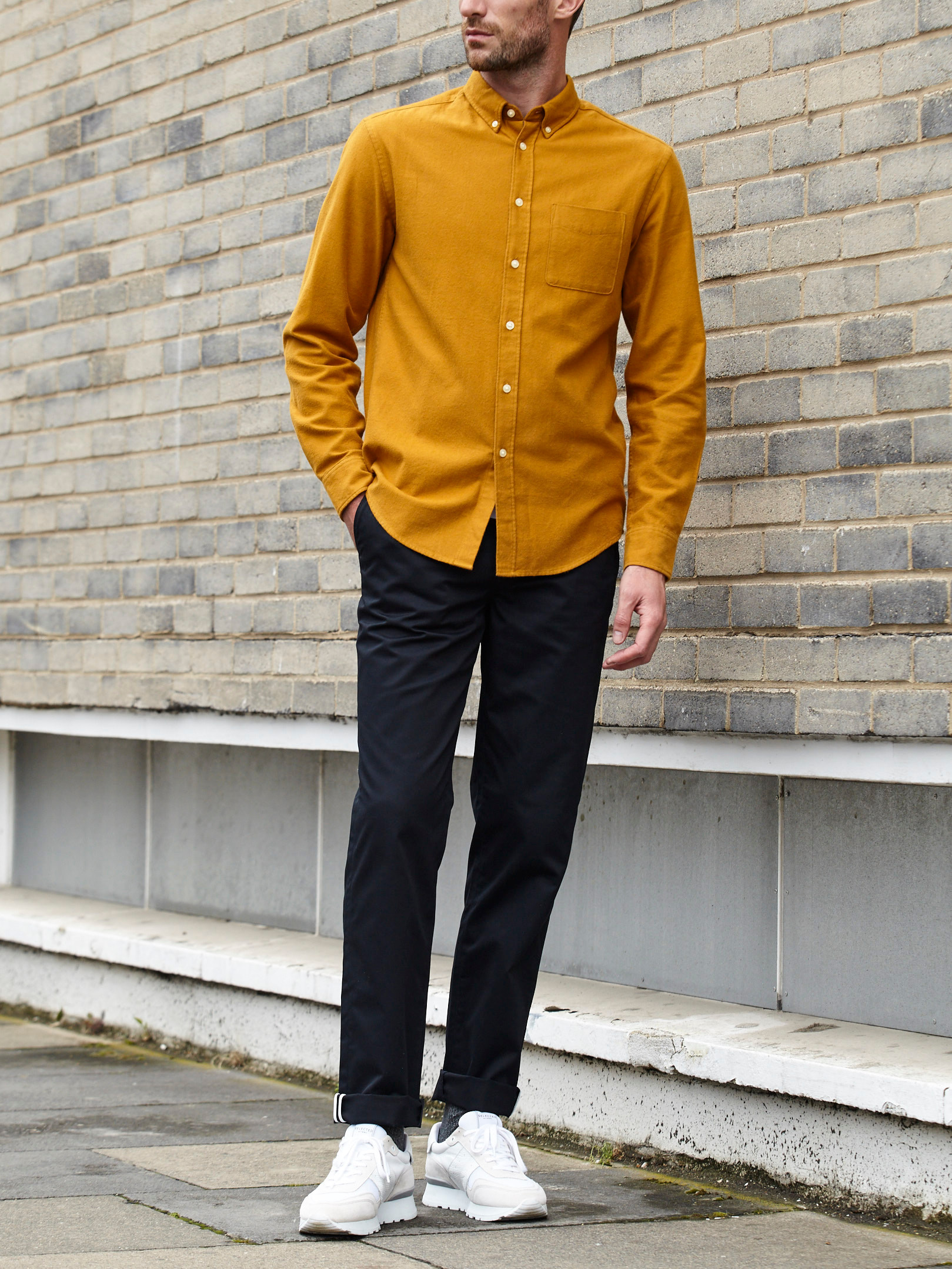 Men's outfit idea for 2021 with bold-colored casual shirt, navy chinos, white sneakers. Suitable for spring and fall.
