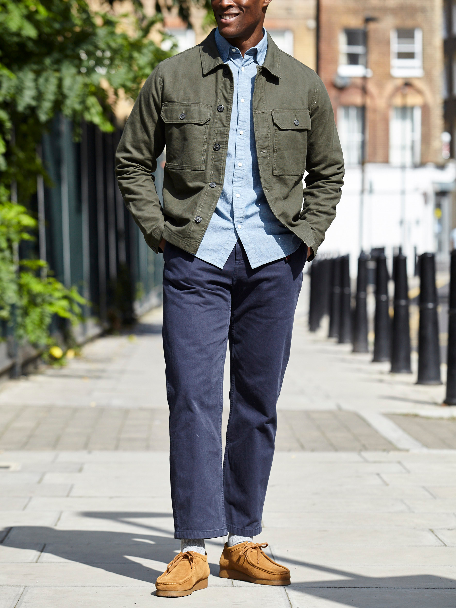 Men's outfit idea for 2021 with green utility jacket, chambray shirt, navy chinos, moccasins / wallabees. Suitable for spring and fall.