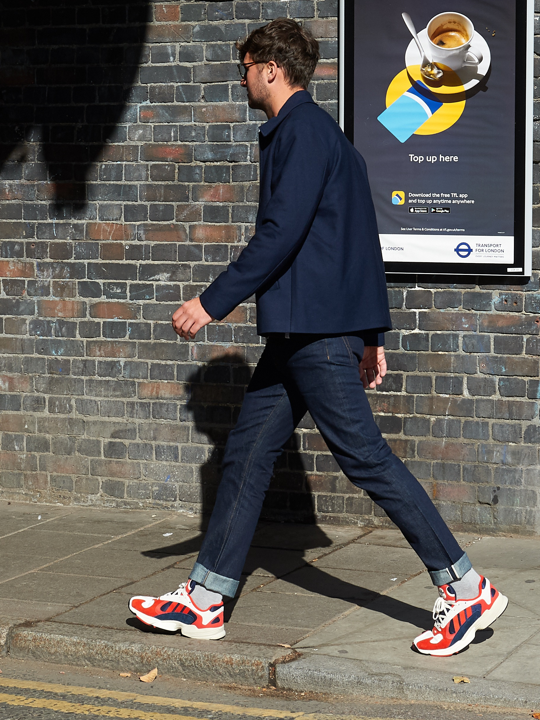 Men's outfit idea for 2021 with utility jacket, dark blue jeans, bright sneakers. Suitable for spring and fall.