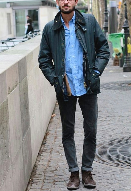 Men's outfit idea for 2021 with green field jacket, blue casual shirt, black jeans, brown desert boots. Suitable for spring, fall and winter.