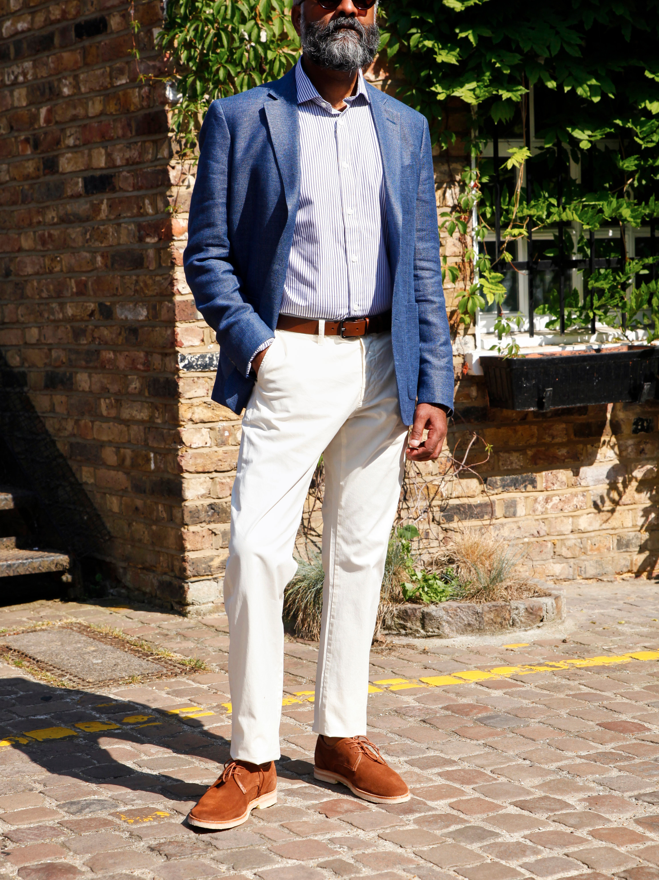 Men's outfit idea for 2021 with unstructured blazer, striped dress shirt, stone chinos, brown dress belt, suede shoes / desert shoes. Suitable for spring and summer.