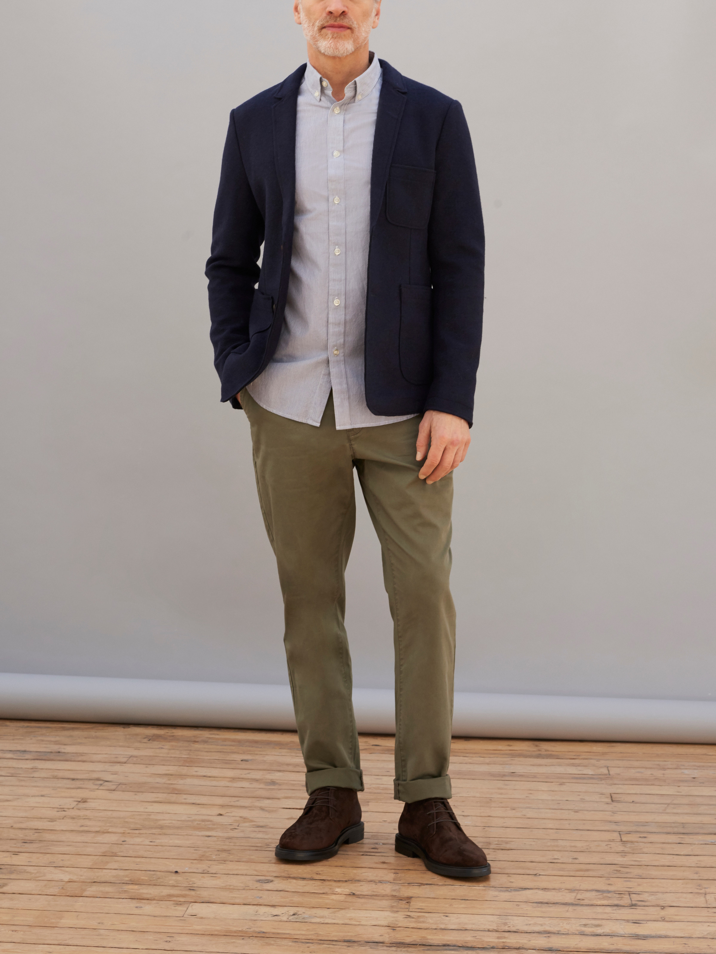 Men's outfit idea for 2021 with textured blazer, striped casual shirt, coloured chinos, brown desert boots. Suitable for spring and autumn.