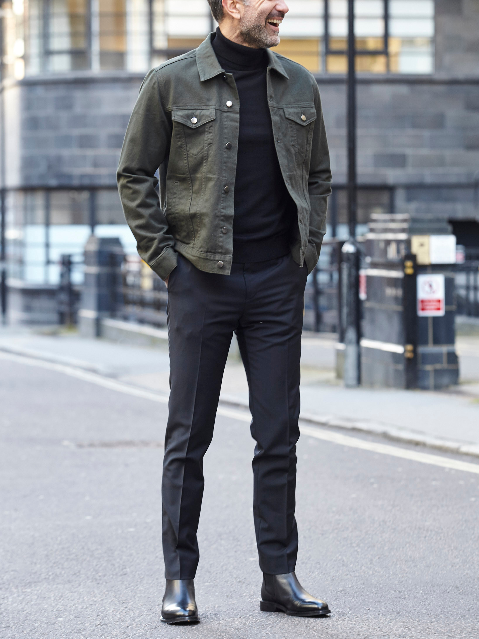 Men's outfit idea for 2021 with green jacket, lightweight rollneck jumper, black formal trousers, black chelsea boots. Suitable for spring and autumn.