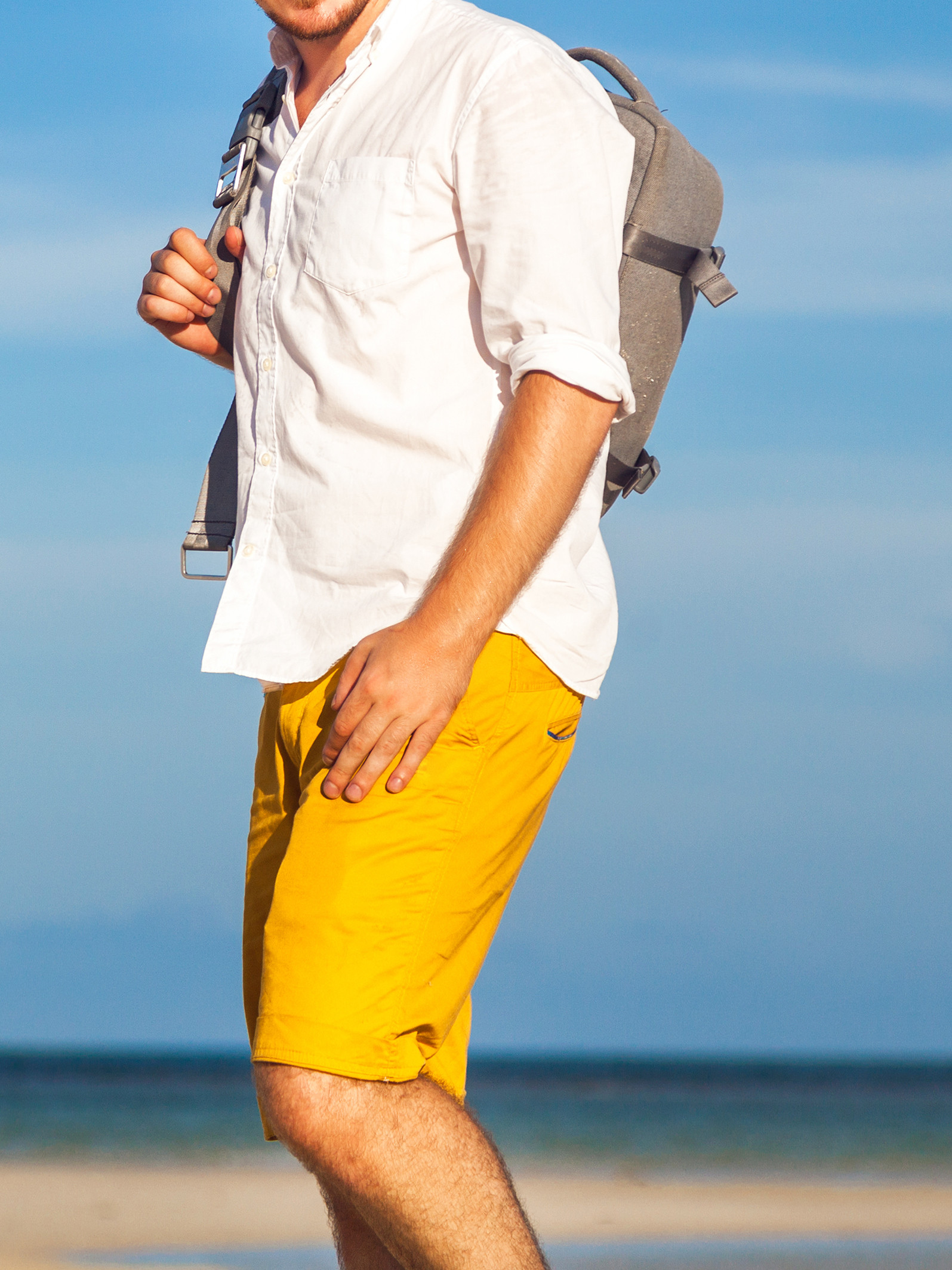 Men's outfit idea for 2021 with linen shirt, swimwear, white sneakers. Suitable for summer.