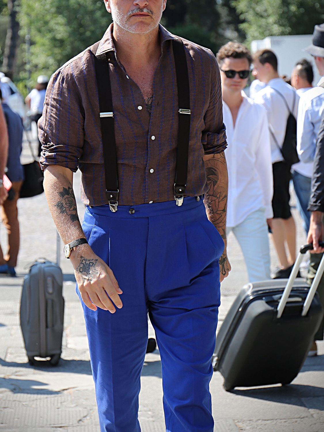 Men's outfit idea for 2021 with blue plain formal trousers, navy braces, brown brogues. Suitable for spring, summer and autumn.