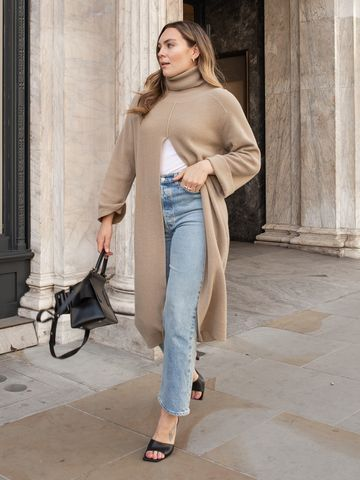 Women's outfit idea for 2021 with neutral dress, white cami, blue jeans, black heels. Suitable for autumn.