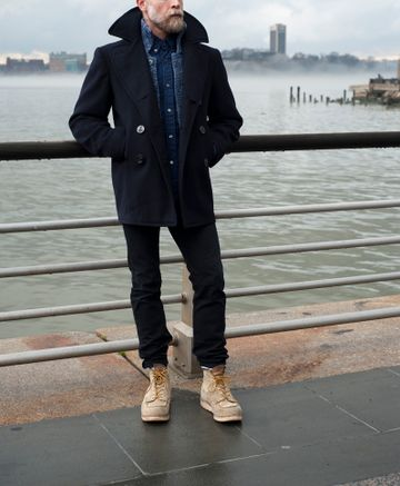 Men's outfit idea for 2021 with pea coat, shawl cardigan, navy casual shirt, black jeans, workboots. Suitable for autumn and winter.