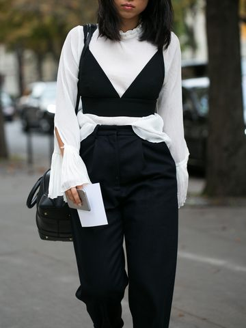 Women's outfit idea for 2021 with white top, black crop top, black smart trousers, black heels. Suitable for spring, autumn and winter.