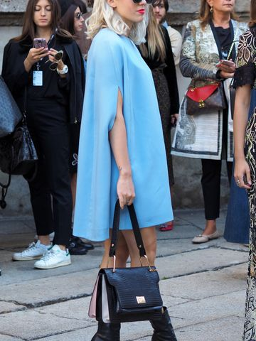 Women's outfit idea for 2021 with blue dress, black sunglasses, black ankle boots. Suitable for spring and autumn.