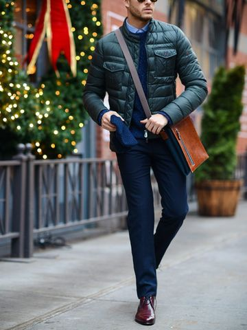 Men's outfit idea for 2021 with quilted jacket, cable-knit jumper, blue formal shirt, navy formal trousers, brown oxford / derby shoes. Suitable for spring, autumn and winter.