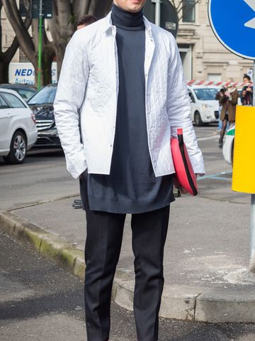 Men's outfit idea for 2021 with white denim jacket, navy lightweight rollneck jumper, navy formal trousers, red wallet, black chelsea boots. Suitable for autumn.