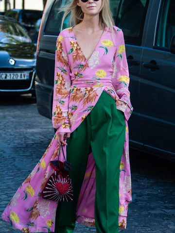 Women's outfit idea for 2021 with pink dress, green casual trousers, white trainers. Suitable for spring and summer.