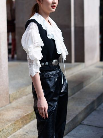 Women's outfit idea for 2021 with black vest, black smart trousers, black ankle boots. Suitable for spring and fall.